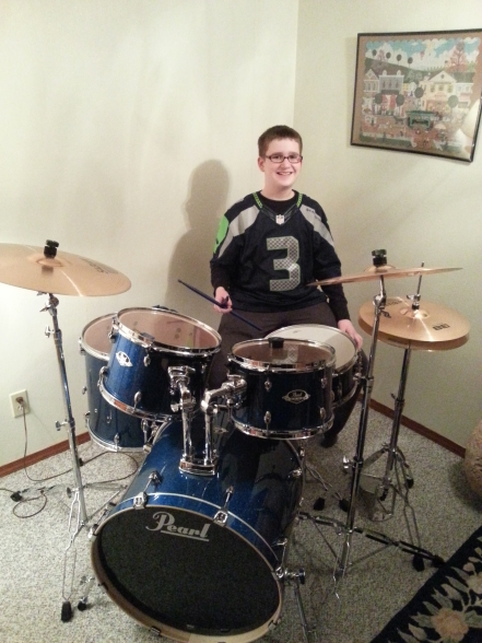 Me with a Russell Wilson jersey on at my new Pearl Export. Go Hawks!